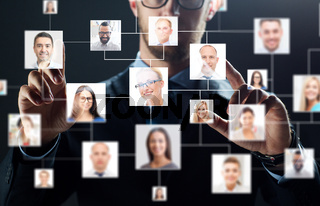 close up of businessman with virtual contact icons