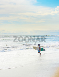 Surfer going to surf, Bali