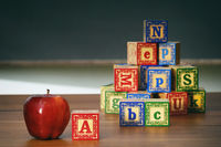 Closeup of wooden blocks and apple