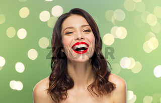 beautiful laughing young woman with red lipstick