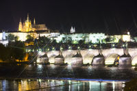 Beautiful Cityscape of Prague at night with Charles Bridge(Karluv Most)  over Vltava river and Prague Castle