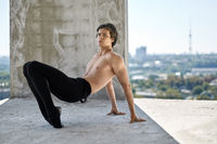 Ballet dancer posing at unfinished building