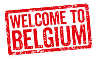 Red stamp on a white background - Welcome to Belgium