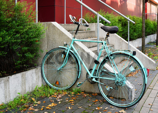 painted bicycle locked to railing
