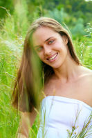 young teenage woman in grass