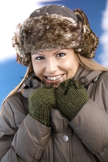 Attractive woman dressed warm smiling freezing