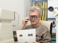 Mature man needs glasses for reading
