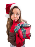 Thinking Girl Wearing A Christmas Santa Hat with Bow Wrapped Gift Isolated on White