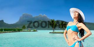 happy woman in bikini tanning on bora bora beach