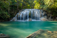Erawan Waterfall with fish in water