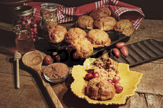 Cranberry muffins with berries on table