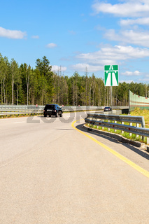 Toll road. Russian highway number M11 in summer day