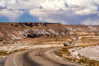 Empty paved road towards Oruro city