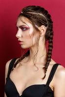 beautiful girl with modern braids and red makeup