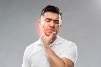 unhappy man suffering toothache