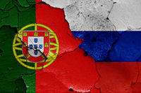 flags of Portugal and Russia painted on cracked wall