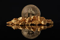 Golden Bitcoin Coin and mound of gold on a dark background.
