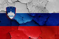 flags of Slovenia and Russia painted on cracked wall