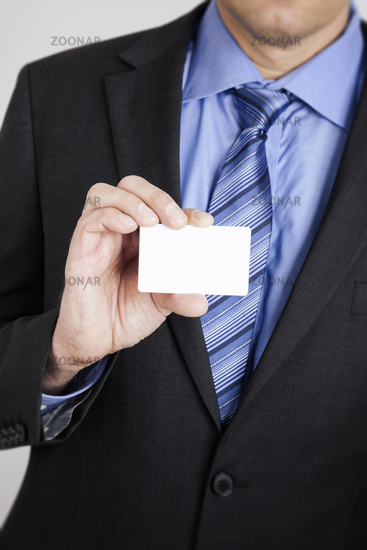 businessman shows his card