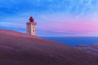 Rubjerg Knude Lighthouse at sunrise on a cold morning
