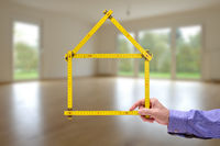 folded pocket ruler in hand of real estate agent as offer for new home