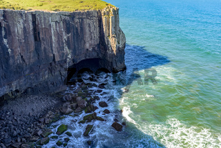 Cliff with cavern over sea