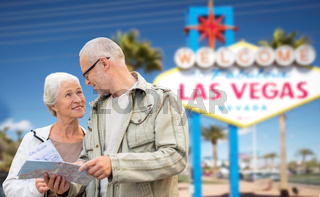 senior couple with map travelling to las vegas