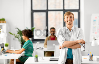 happy smiling man with glasses at office