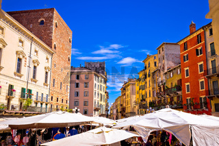 Piazza delle erbe in Verona colorful architecture and market view