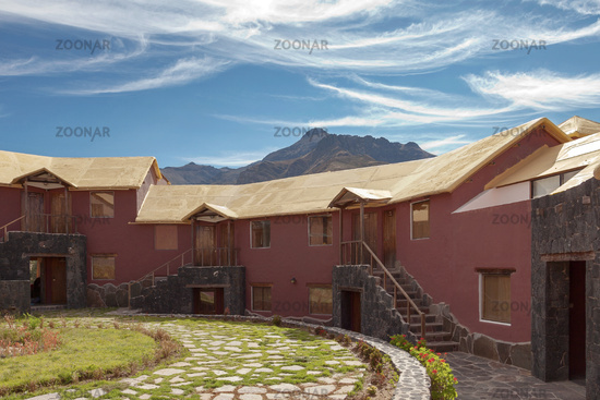 A traditional vintage hotel in Chivay, Arequipa Peru with mountains and blue sky