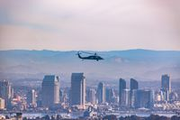 Summer in the San Diego. San Diego Skyline looking hazy and Military Choppers in the Sky