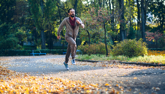 Healthy active man running in the park.