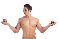 Sport Bodybuilder Bodybuilding essen Diät abnehmen fit schlank Apfel Frucht Hamburger