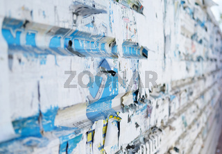 Wall with an old torn posters