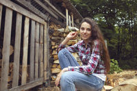 Beautiful youngcountry  woman on firewood background