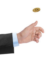Hand tossing a bitcoin