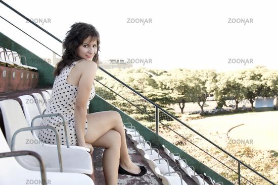 Retro girl sitting in stadium
