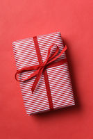Christmas present wrapped in red and white striped paper