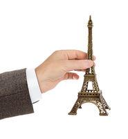 Paris Eiffel tower souvenir in hand