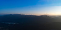 Aerial view of the mountains at sunrise. Beautiful panorama landscape. Laos.