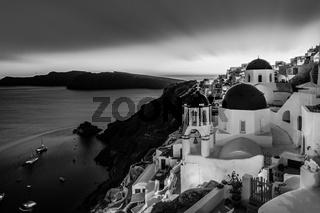 Traditional greek village of Oia in black and white, Santorini island, Greece.