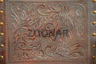 Vintage floral pattern on leather