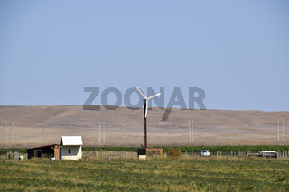 Wind power plant. A wind turbine in the field for generating electricity.