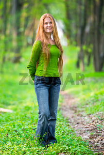 Pretty woman with red hair in the park