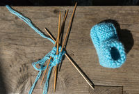knitting of socks of blue wool