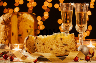 Sliced italian panettone and sparkling wine