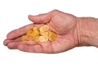 Pure gold tenth ounce coins in senior man hand