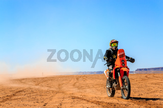 Ait Saoun, Morocco - February 22, 2016: Unidentified man in helmet riding bike in Ait Saoun desert of Morocco.