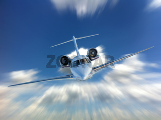 Private Jet airplane flying. Front view.