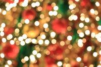 Christmas tree on abstract light golden bokeh background.